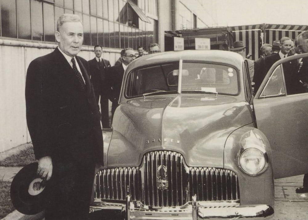 The Prime Minister, Ben Chifley, stands with the first Holden automobile produced in Australia, November 29, 1948
